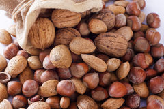 Mix nuts in sack. Almonds, hazelnuts Stock Photography