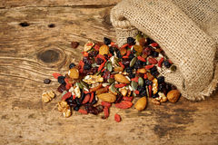 Mix nuts seeds and dry fruits, on a wooden table stock photos