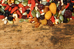 Mix nuts seeds and dry fruits, on a wooden table royalty free stock photo