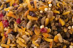 Mix of nuts and sundried fruit dried apricots, dried cherries, dried figs, raisins at farmers market. royalty free stock photography