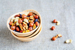 Mix nuts - walnuts, hazelnuts, almonds, raisins Stock Photos