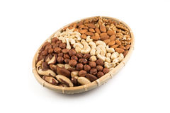 Mix nuts in wicker basket Stock Images