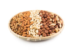 Mix nuts in wicker basket Royalty Free Stock Image