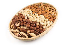 Mix nuts in wicker basket Royalty Free Stock Photos