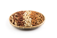 Mix nuts in wicker basket Stock Photo