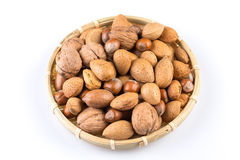 Mix nuts in wicker basket Stock Image