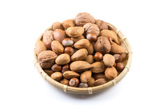 Mix nuts in wicker basket Stock Photography