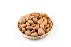 Mix nuts in wicker basket Royalty Free Stock Images
