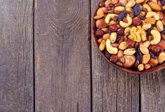 Mix nuts on plate on wood background Royalty Free Stock Photos