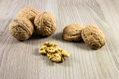 Mix of nuts. On a wooden background Royalty Free Stock Images