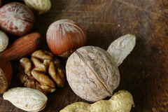 Mix nuts on a wooden background Stock Photo