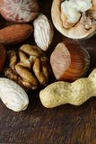 Mix nuts on a wooden background Stock Images
