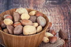 Mix nuts in a wooden bowl Stock Image