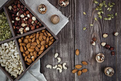 Mix nuts on wooden box and table,healthy vegan food. Royalty Free Stock Photography