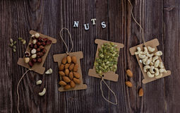 Mix nuts on wooden table,healthy vegan food. Royalty Free Stock Image