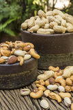 Mix nuts on a wooden table. Pigeon peas mixed nuts such as pistachios, peanuts, cashews and almond on a wooden table Stock Photography