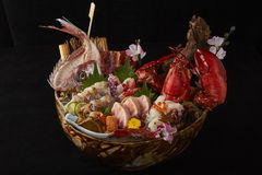 Mix oceans. Sashimi is a Japanese delicacy consisting of very fresh raw meat or fish sliced into thin pieces Royalty Free Stock Image