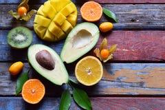Mix Of Ripe Tropical Fruits With Avocado, Mango, Kumquat, Kiwi, Citrus. Superfood Background. Vegetarian Raw Food. Copy Space Stock Image