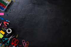 Mix of office supplies. On black background. Top view, copy space royalty free stock image
