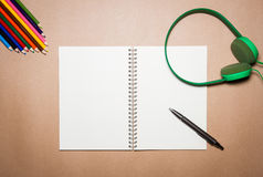 Mix of office supplies and gadgets on a brown paper. View from above Stock Images