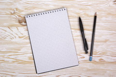 Mix of office supplies and gadgets on a wooden background. Stock Photos