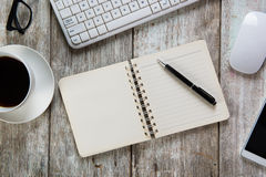 Mix of office supplies and gadgets. On a wooden table background. View from above Royalty Free Stock Images