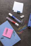 Mix of office supplies on a wooden desk background. Stock Photography