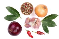 Mix of onion, garlic, hot pepper, peppercorn and laurel leaf isolated on white background. Top view Stock Photo