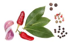Mix of garlic, hot pepper, peppercorn and laurel leaf isolated on white background. Top view Stock Photos