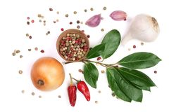 Mix of onion, garlic, hot pepper, peppercorn and laurel leaf isolated on white background. Top view Stock Photos