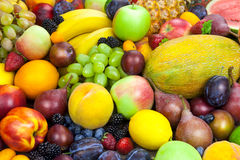 Mix of organic fruits - background Stock Photography