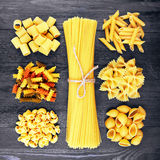 Mix of pasta on wood Royalty Free Stock Image