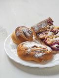 Mix of pastries. Homemade buns on white plate. Selective focus on the front Stock Photography