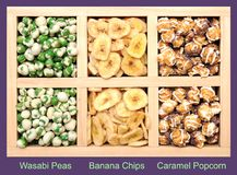 Mix of pea, banana and popcorn Royalty Free Stock Images