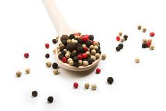 Mix of pepper seasoning in a wooden spoon Stock Photo