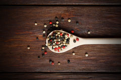 Mix of pepper seasoning in a wooden spoon Stock Photos
