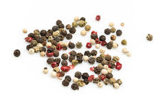 Mix pepper. Seeds on a white background royalty free stock image