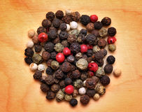 Mix of peppers macro on wooden board Royalty Free Stock Images