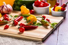 Mix of peppers with tomato, garlic and olive oil royalty free stock images