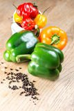 Mix of peppers on wooden table Stock Photography