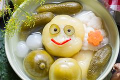 Mix of pickled vegetables on table happy fun food concept Stock Photos