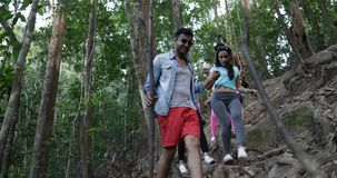 Mix Race Group Of Tourists Walking Down Hill On Hike, Hikers Team Explore Forest Path Together Diverse People Trekking. Slow Motion 60 stock video