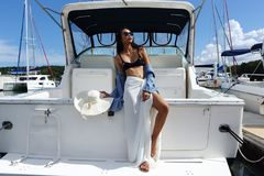 Mix Race Tanned skin Woman walk along Luxury Yachts in Marina Ba royalty free stock photos