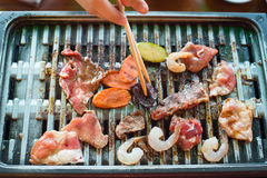 Mix raw meat grilling on grill grate Stock Images