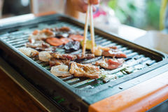 Mix raw meat grilling on grill grate Royalty Free Stock Photos