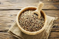 Mix of raw red, white and black quinoa on thw wooden table Royalty Free Stock Photography
