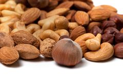 Mix of raw and roasted nuts Royalty Free Stock Photo