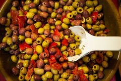 Mix  and red pepper in wooden bowl at the food market Royalty Free Stock Images