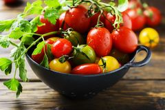 Mix of red, yellow and green tomatos Stock Images