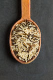 Mix of rice in an wooden spoon on a black background Royalty Free Stock Photos
